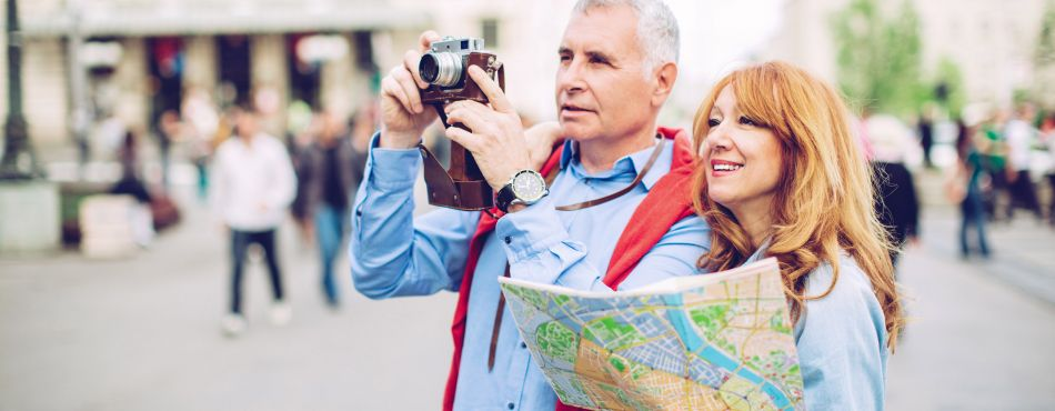 Couple with a Map and Camera